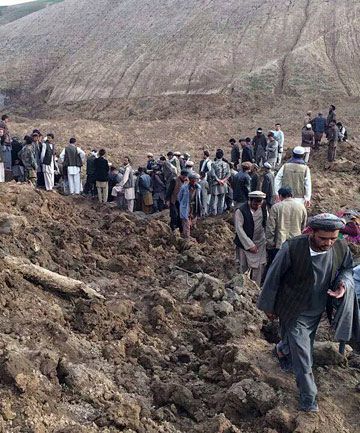 MASSIVE SLIP: Afghan villagers gather at the site of a landslide at the Argo district in Badakhshan province. Hundreds of people are dead and 2000 are missing.