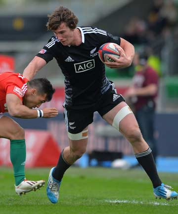 GETTING AWAY: New Zealand's Sam Dickson attempts to fend off Portugal's Manuel Raposo during their pool match at the Glasgow Sevens.