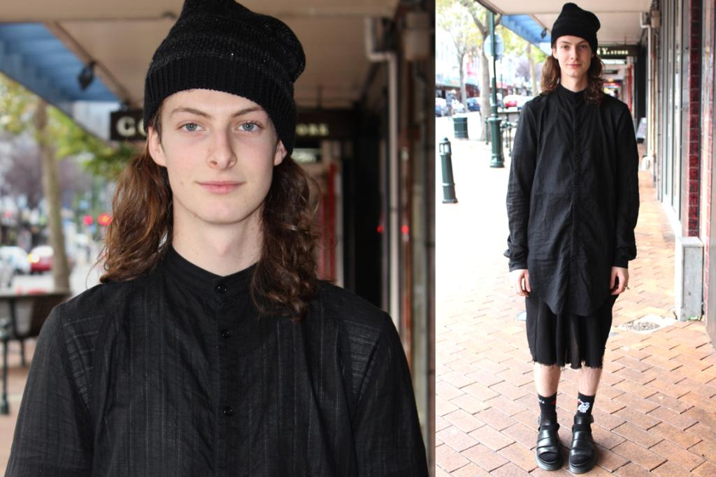 iD Fashion Week model Krue showcases his love of all things black on George St, Dunedin in Nom*d and Dr Marten sandals.