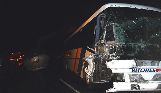 Bus crashes into milk tanker