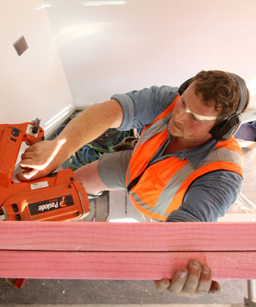 NAILED IT: Phoenix Services carpenter Chris Magennity works on the new counsel lawyer instruction suite at the Invercargill District Court.