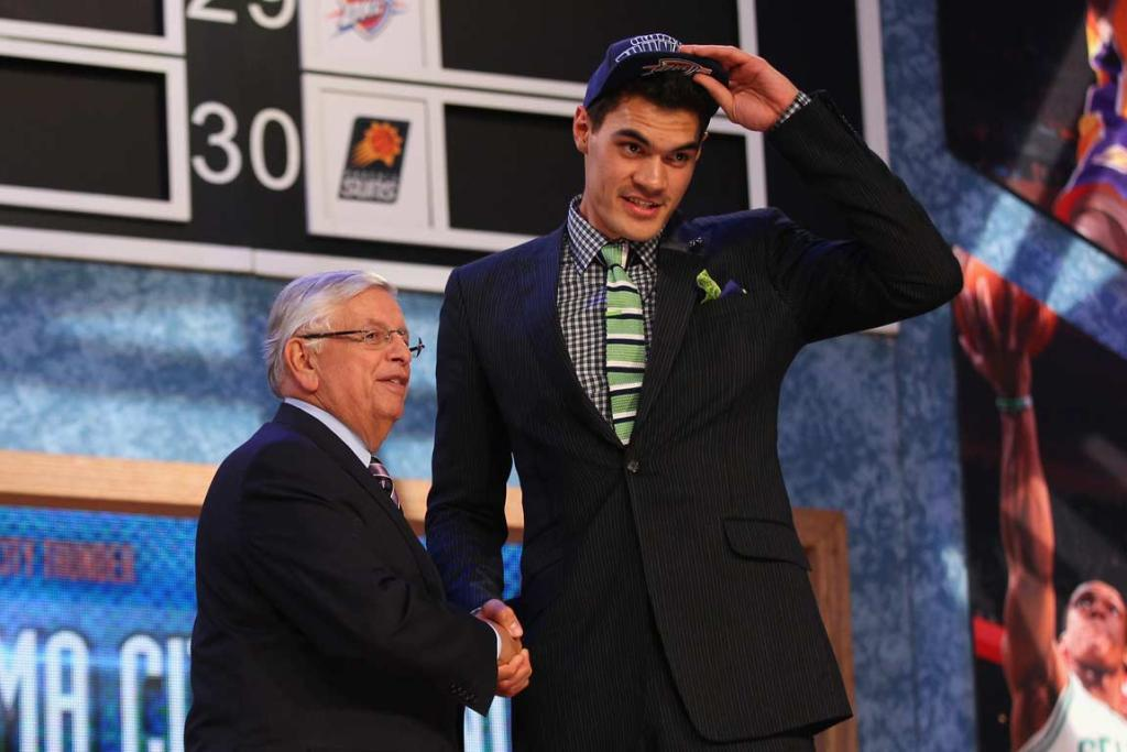 Steven Adams shakes hands with NBA commissioner David Stern after being drafted in the first round in June 2013.