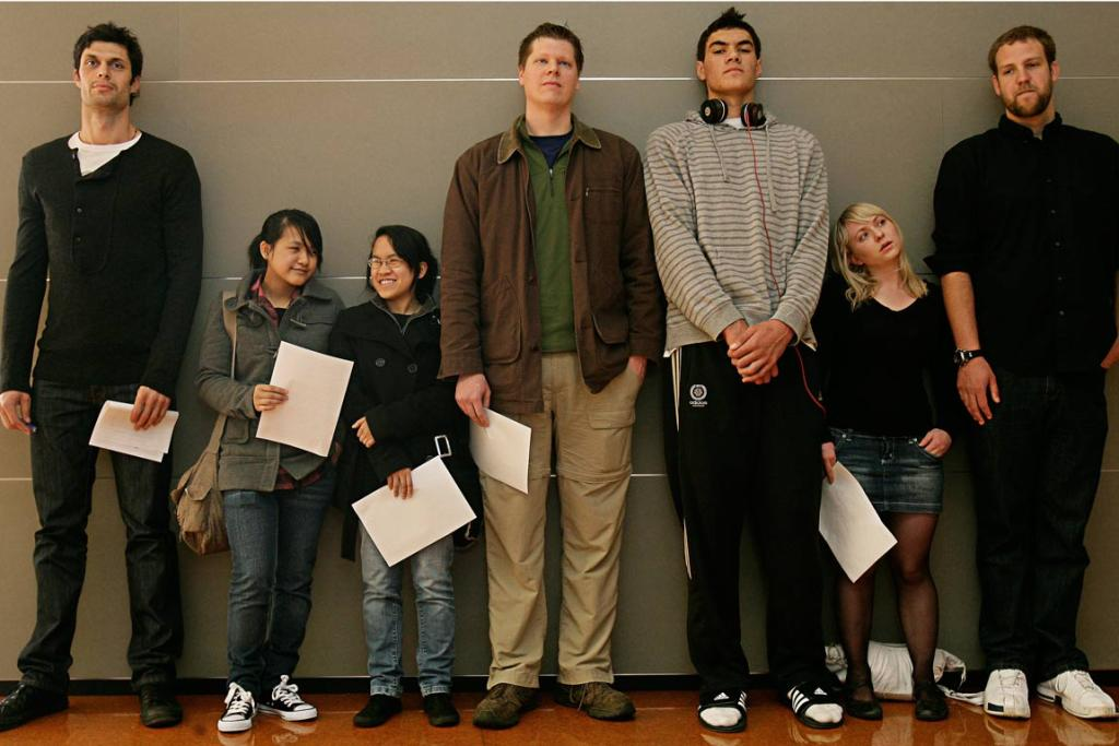 Adams, third from right, lines up with people tall and short during a casting call for The Hobbit in 2010 at the Te Whaea National Dance and Drama Centre in Wellington.