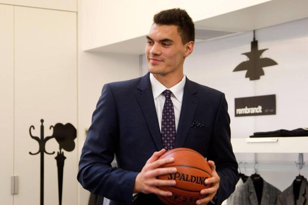 Steven Adams gets a tailor-made suit from New Zealand menswear manufacturer Rembrandt before heading to the USA for the NBA draft in 2013.