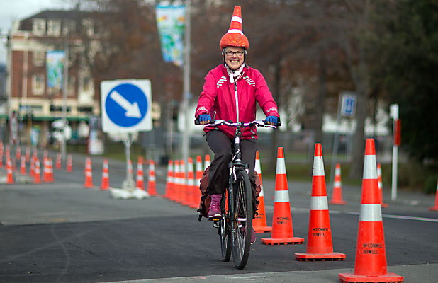 TRAFFIC FUN: Sandy Turner has made a woolly roadcone hat to amuse commuters and spread joy.