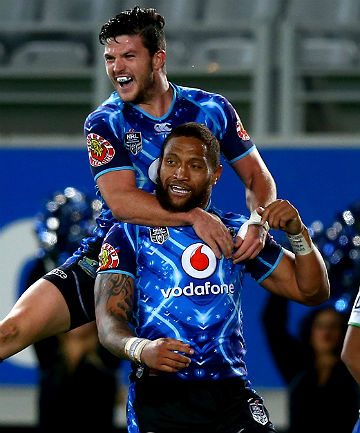 WE'RE ROMPING HOME: Manu Vatuvei of the Warriors, bottom, is congratulated by Chad Townsend after scoring against the Raiders at Eden Park in Auckland.