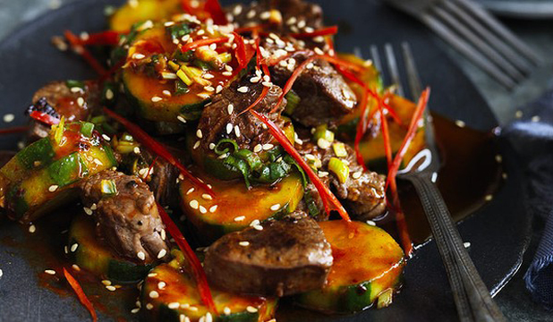 BURSTING WITH FLAVOUR: Add some chopped kimchi and rice to make a meal of this fiery beef and cucumber combination.