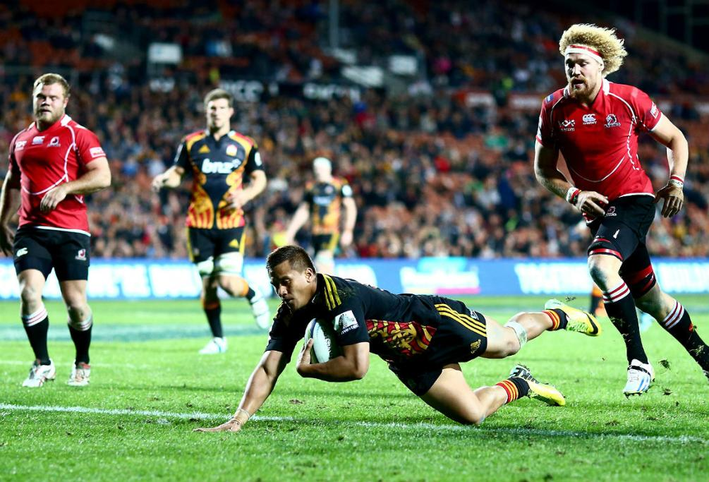 Tim Nanai-Williams of the Chiefs scores a try against the Lions in Hamilton.