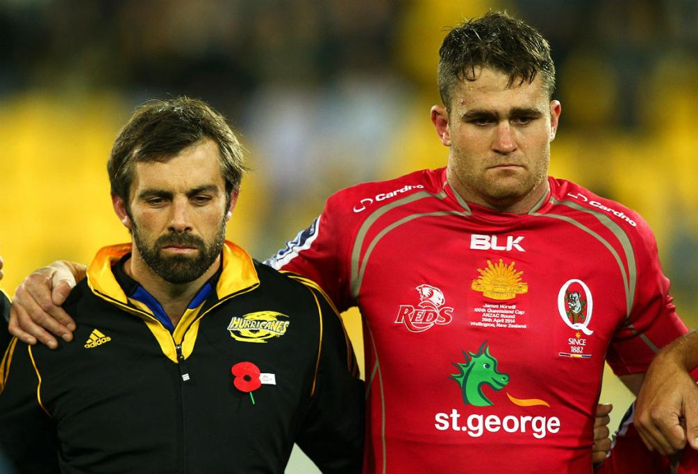 Conrad Smith of the Hurricanes and James Horwill of the Reds share a moment's silence to mark Anzac Day.