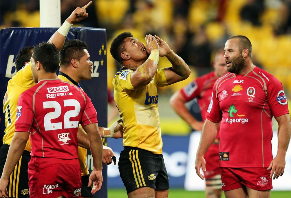 Hurricanes flanker Ardie Savea celebrates his try against the Reds at Westpac Stadium in Wellington.
