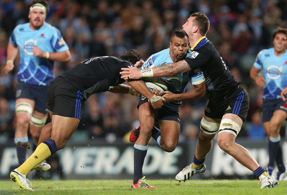 Kurtley Beale of the Waratahs meets some stern Hurricanes defence in Sydney.