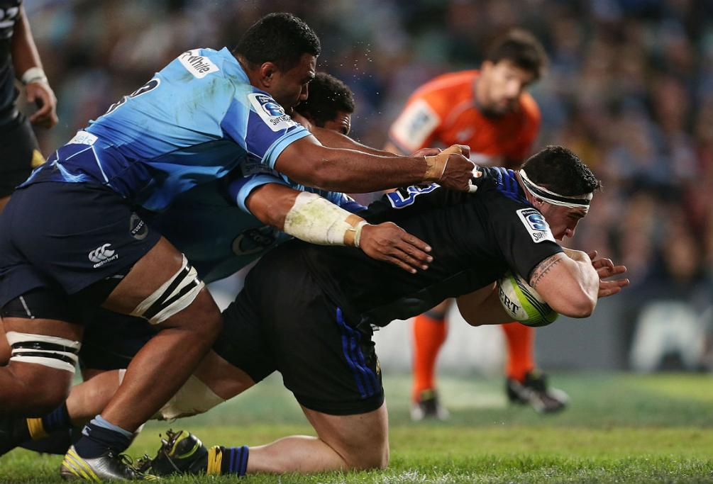 Jeffery Toomaga-Allen of the Hurricanes scores a try against the Waratahs in Sydney.