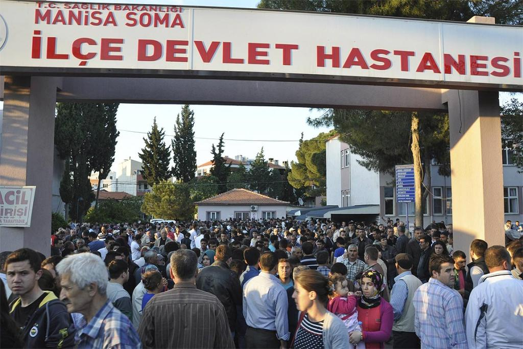 Locals and relatives of miners who are trapped in a coal mine wait in front of a hospital in Soma, a district in Turkey's western province of Manisa.