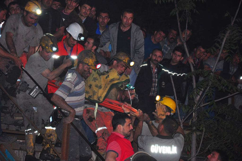 Search and rescue teams and officials are seen around a coal mine where miners are trapped near Soma.