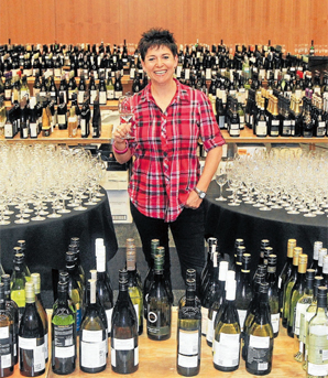 WORTH THE WORK: Director of Wine Competition Ltd Belinda Jackson among the many entries at the Marlborough Wine Show in Blenheim last year.