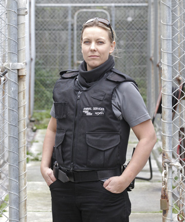 VESTED INTEREST: Hutt Valley dog control officer Vicki Harwood has been wearing a stab-proof vest to work  for the past 12 months. She says even the simplest job can get out of hand quickly.
