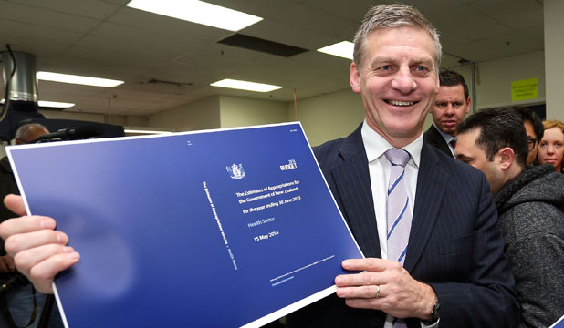 PRINTING PRESS: Bill English watches the 2014 Budget roll off the presses.