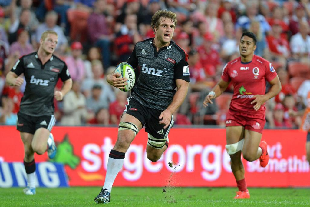 Luke Whitelock of the Crusaders breaks away from the defence to score a try during the round 13 Super Rugby match between the Reds and the Crusaders.
