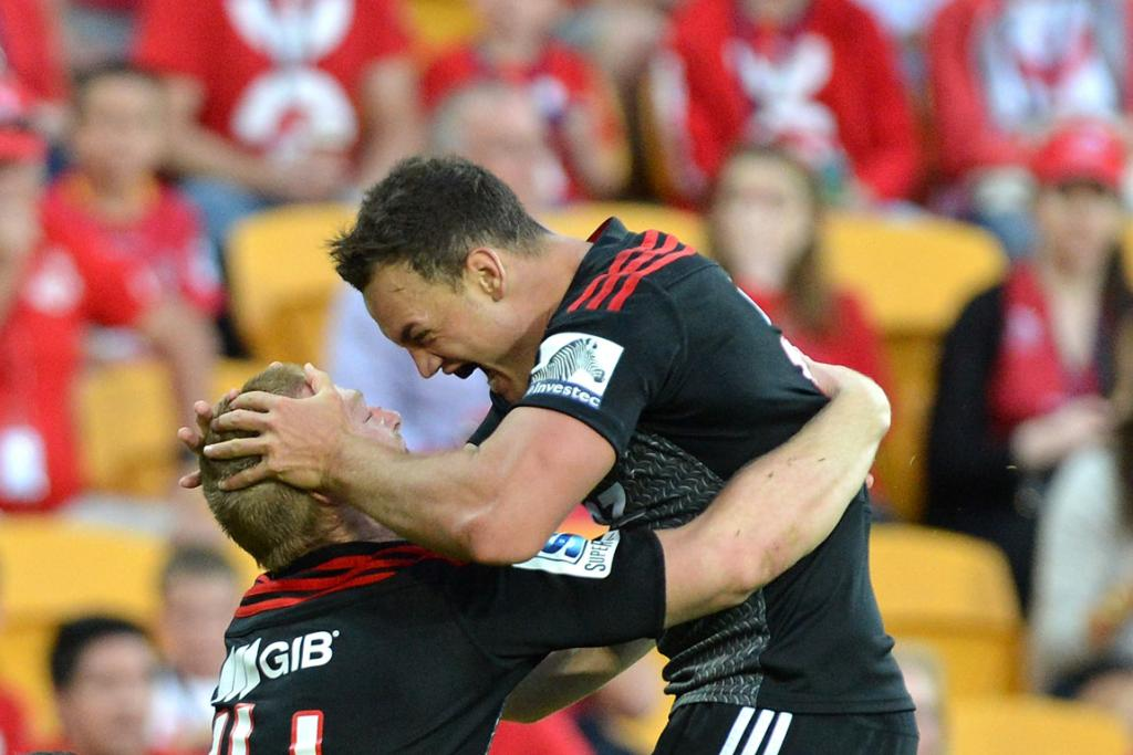 Johnny McNicholl of the Crusaders celebrates with team mate Israel Dagg after scoring a try during the round 13 Super Rugby match between the Reds and the Crusaders.