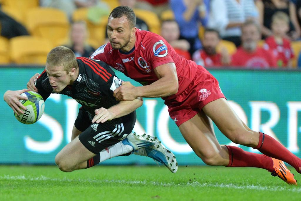 Johnny McNicholl of the Crusaders scores a try during the round 13 Super Rugby match between the Reds and the Crusaders.