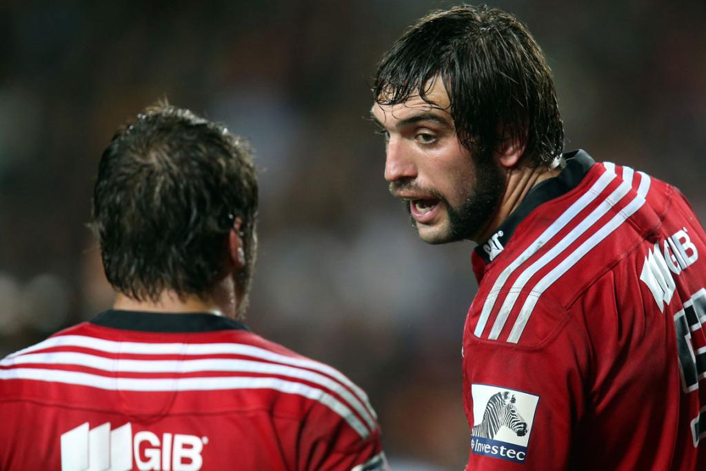 Samuel Whitelock of the Crusaders has a word with a team-mate during the Chiefs and Crusaders Super Rugby match.