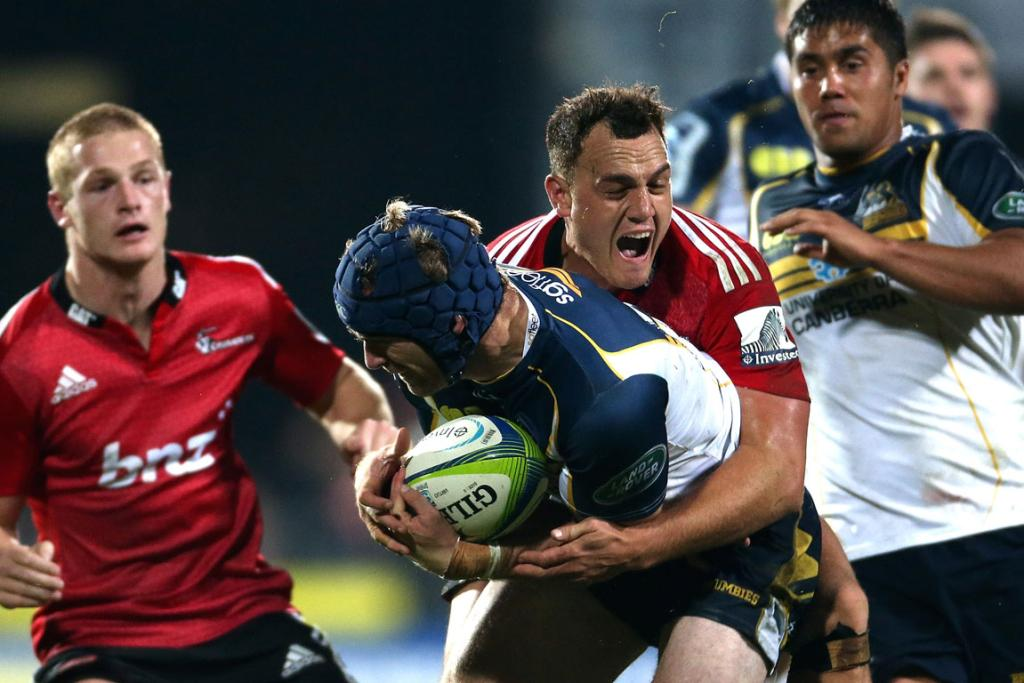 Pat McCabe of the Brumbies is tackled by Israel Dagg of the Crusaders.