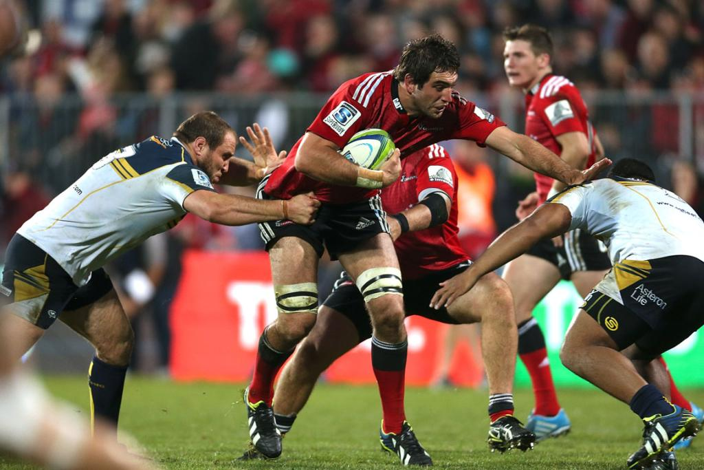Sam Whitelock of the Crusaders is tackled during the round 12 Super Rugby match between the Crusaders and the Brumbies.