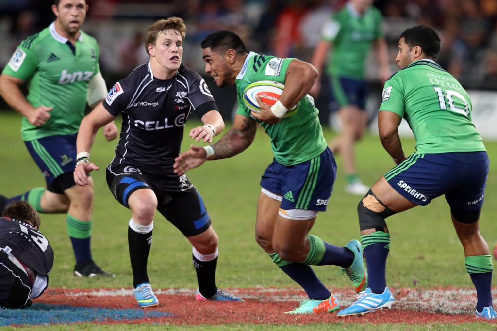 Malakai Fekitoa of the Highlanders looking to attack SP Marais of the Sharks.