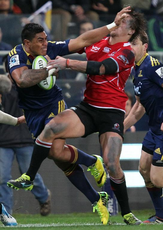 Malakai Fekitoa of the Highlanders puts in a fend during Super Rugby match between the Highlanders and the Lions.