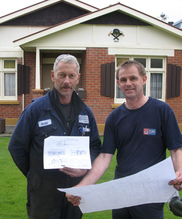 MAKING WAY: Alexandra Volunteer Fire Brigade chief officer Russell Anderson and deputy chief fire officer Mark Hutton with the plans for the new fire station building.