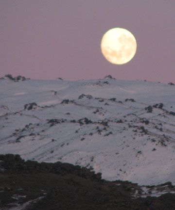 CHANGING IS COMING: Moon over the Old Man Range, block mountains because of their relatively flat tops.