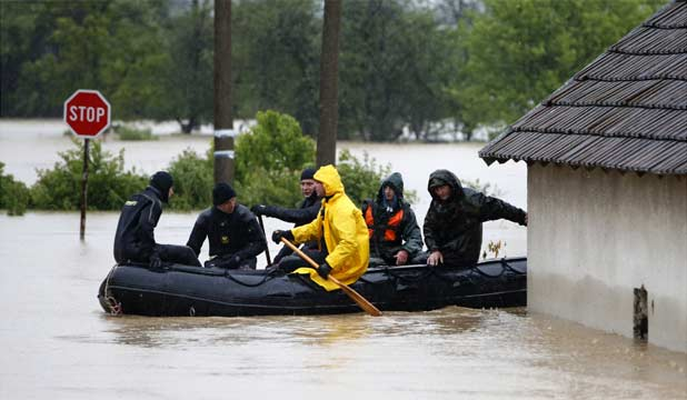 WET RESCUE: Serbian police officers sit in a boat during a rescue operation in the town of Lazarevac, south of Belgrade, amid the worst floods in the Balkans in 120 years.