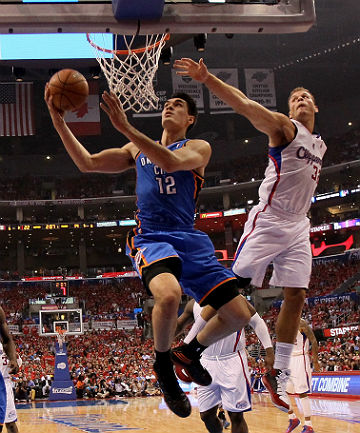 KIWIS REALLY CAN FLY: Steven Adams jumps highest to score for the Oklahoma City Thunder.
