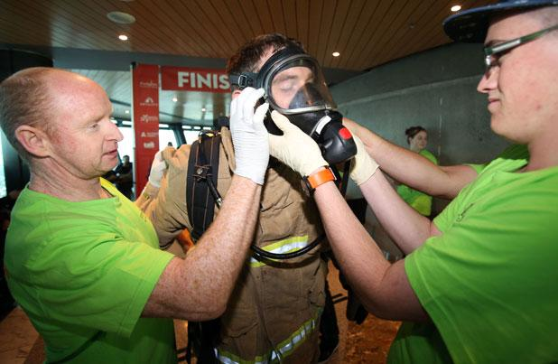 Firefighters climb sky tower