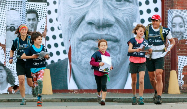 Orienteering competitors Jodie and Nathan Fa'avae with their children Zephyr, 9, left, Tide, 7, and Jessie, 11, taking part in the Metlink City Safari.