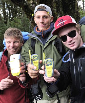 KITTED OUT: Trampers Cliff Peady, of Australia, left, Herman Pontow, of Germany. and American Mason Noyes of USA, look forward to walking the Milford Track out of season but are well prepared and have each taken a personal locator beacons with them in case they run into trouble.