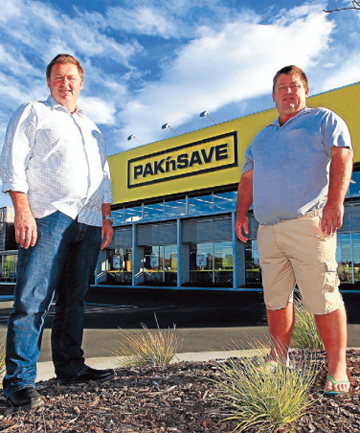 LOCAL KNOWLEDGE: Robinson Construction owners Phil and Nick Robinson outside the building that won the national category for a retail project at the Registered Master Builders new commercial project awards.