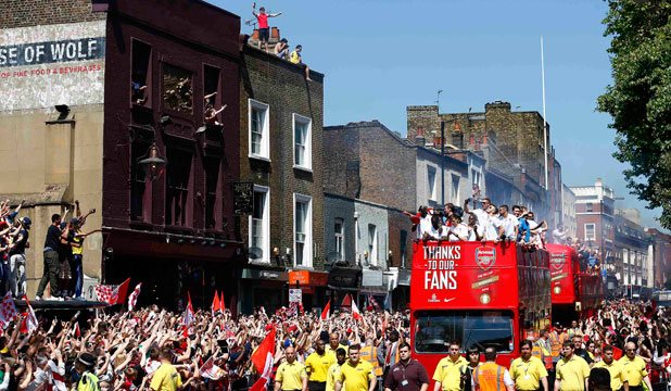 LONDON PARTY: Tens of thousands line the streets to celebrate the Gunners' FA Cup victory.