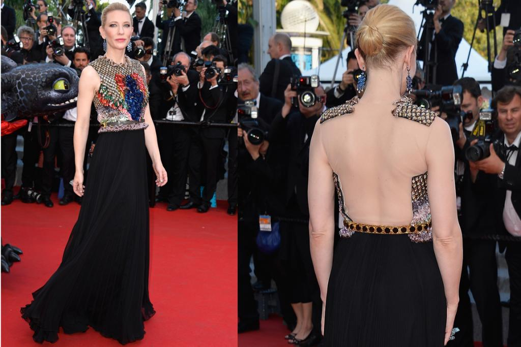 DAY THREE, THE MIXED: While we rarely dislike a gown that's structured up top and flowy down below on Cate Blanchett, the strange flaps of fabric and nude illusion mesh on the back of this look is throwing us off. If anyone can pull off slightly strange embellishments it's Cate, but it's as though the Givenchy couturiers just ran out of patience half way through crafting the bodice and thought well hey - why not just chuck some see-through fabric on, tuck the leftover bits under a belt and call it a day.
