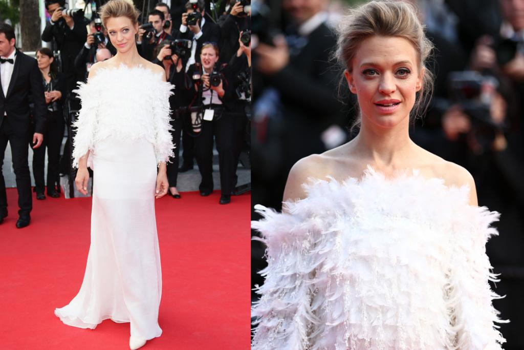DAY THREE, THE BAD: Against the glamorous ballgowns and classy suits, German actress Heike Makatsch is a feathery mess in this strange white creation. We're all for feathers, and could see how the look could be redeemed if the sleeves were to magically disappear, but right now it's just horribly unflattering.