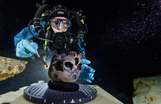 UNDERWATER BOUNTY: Diver Susan Bird inspects the skull on an underwater turntable.