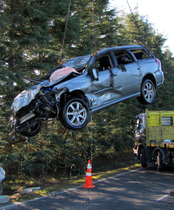 RECOVERY: A car is lifted from a stream by a crane following a fatal crash near Havelock North.