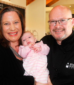 FAMILY BUSINESS:  French Essence Café owners Sarah and Dave Anderson with their 8-week-old daughter Cleo in their popular Redwoodtown cafe.
