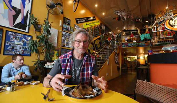 BIG CHANGES: Paul Clark of Zookeepers cafe in Invercargill, with a muttonbird plated up. The cafe is changing its menu for the first time in 21 years.