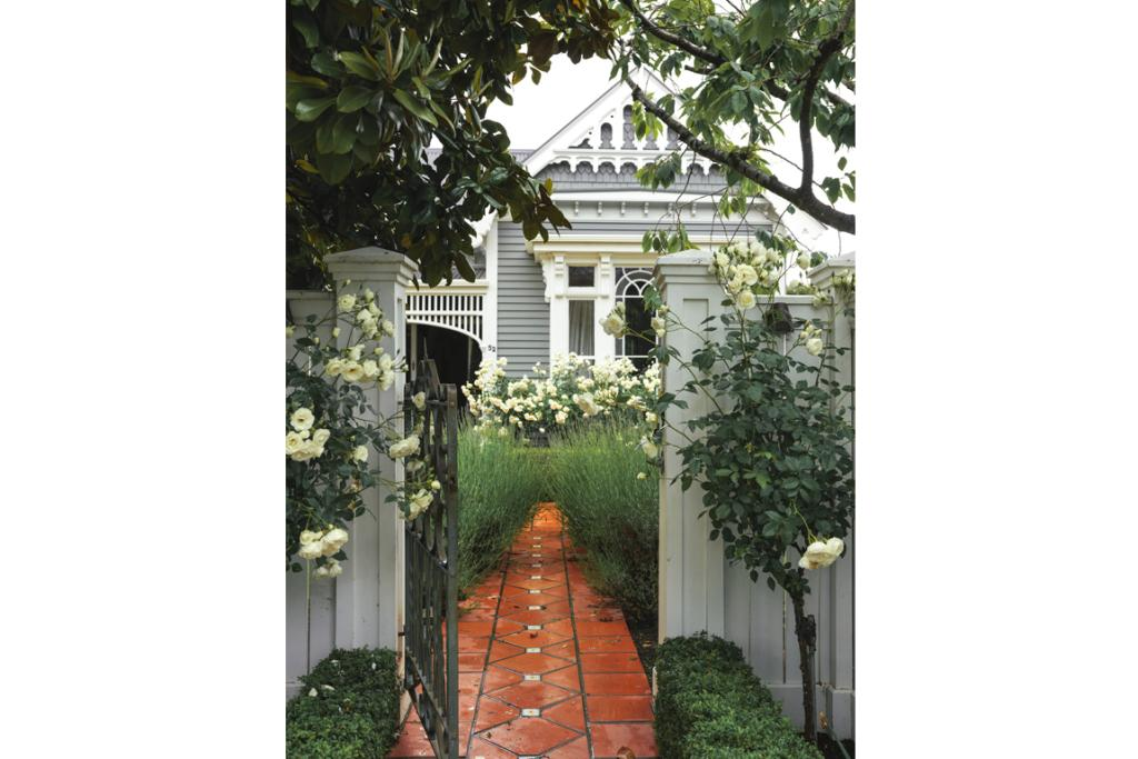 Iceberg roses, lavender and buxus lead to the entrance of this Christchurch villa belonging to Amber and John Hamilton.