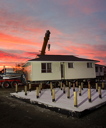 MOVING TIME: A red-zoned house renovated by prisoners is placed on a new site at Rowses Rd, Aranui.