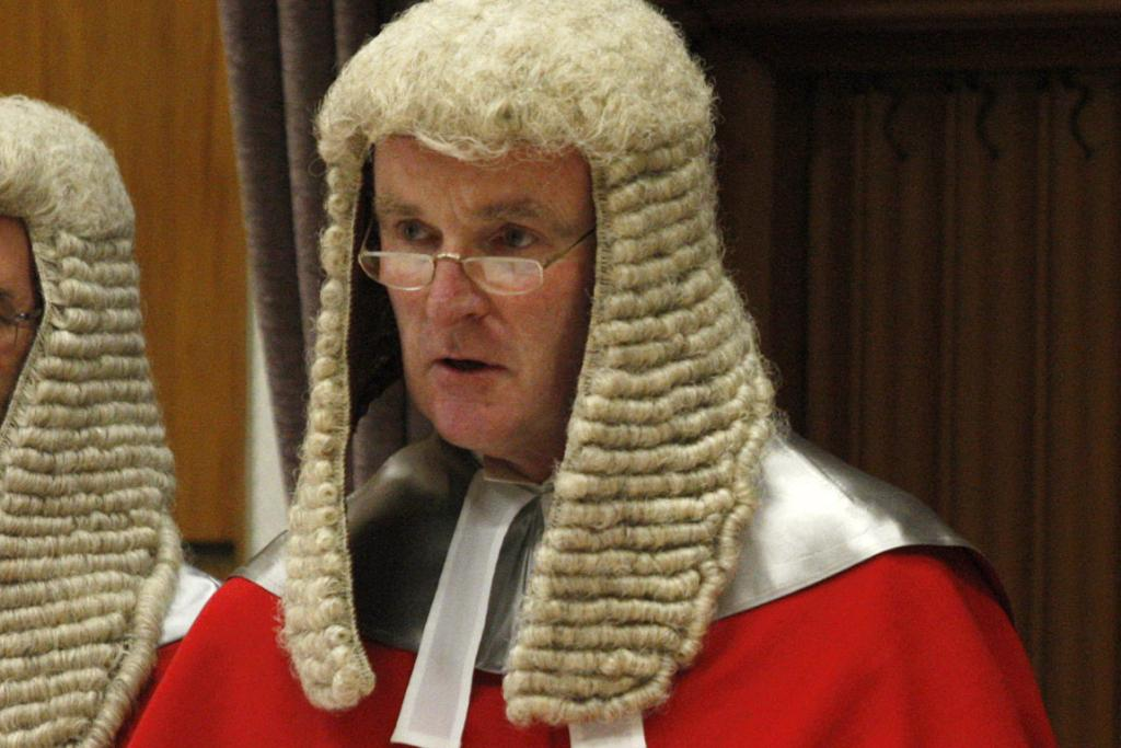 JUSTICE EDWIN WYLIE: The judge hearing the case.