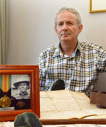 PERSONAL EFFECTS: Keith Sloane with medals, wartime papers, Sam Browne belt and riding crop his grandfather wore.