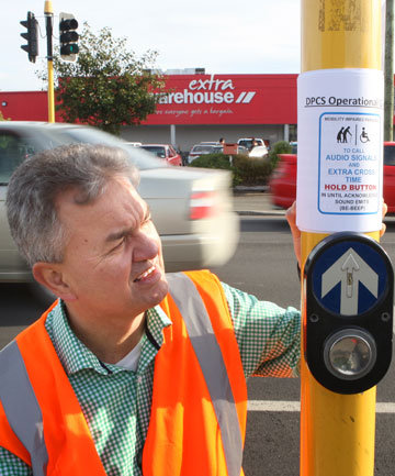 PEDESTRIAN PLEASER: Traffic engineer Eddie Cook with his new invention – about to be implemented in Invercargill – that reduces or increases  time to cross the road with a press of the button.