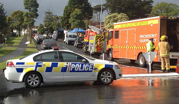CORDON: Police and emergency services swooped on Luanda Dr, Ranui, after reports of the shootout.